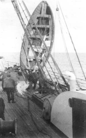 Lifeboat being emptied of water on Carpathia deck